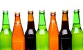 A row of top beer bottles on white background with reflection Royalty Free Stock Images