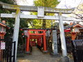 Row of toriis gate for garden temple in ueno park tokyo japanese traditional building red at entrance hanazono inari shrine japan Royalty Free Stock Photo