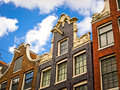 Row of typical historic house facades in Amsterdam Royalty Free Stock Photo