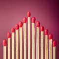 Row of unburned matches over red background Royalty Free Stock Images