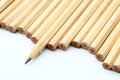 Row of unused pencil with one sharpened white background Stock Images