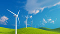 Row of wind turbines on green fields Royalty Free Stock Photo