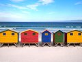 Row of wooden brightly colored huts on sunrise beach atlantic ocean cape town muizenberg south africa Royalty Free Stock Photography