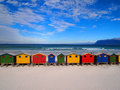Row of wooden brightly colored huts on sunrise beach atlantic ocean cape town muizenberg south africa Stock Image