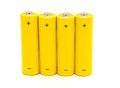 Row yellow aa batteries white background Royalty Free Stock Image