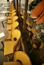 A row of yellow coloured wicker chairs outside a paris cafe Royalty Free Stock Image