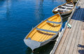 Rowboat in harbour tied up to a wooden jetty on lake union seattle Royalty Free Stock Image