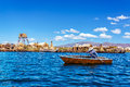 Rowboat on lake titicaca at uros floating islands near puno peru Stock Photos