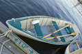 Rowboat a with oars tied up at a dock Stock Images