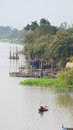 Rowboat the is running on the chaopaya river thailand and can see livestyle on the side of river Stock Images