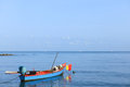Rowboat in the sea calm under clear blue sky Royalty Free Stock Images