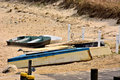 Rowboats abandoned on a beach left sandy cape cod Royalty Free Stock Photo