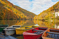 Rowboats ashore on lake Hamori in autumn Royalty Free Stock Photo