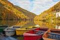 Rowboats ashore on lake Hamori in autumn Royalty Free Stock Photo