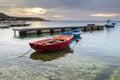 Rowboats docked in sea port Stock Image