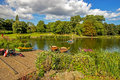 Rowboats docked in small lake at park in Birmingham, England Royalty Free Stock Photo