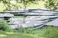 Rowboats tied to the dock at the shore of a rowing pond Royalty Free Stock Photo