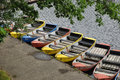 Rowboats varied colored waiting for tourists Stock Images