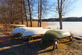 Rowboats in winter storage at sunny spring morning Royalty Free Stock Images