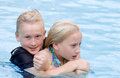 Rowdy Boy Holding Girl in Pool Water Royalty Free Stock Photo