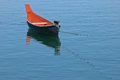 Rowing boat floats on calm lake blue Stock Image