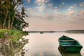 Rowing boat on the lake elk floating over waters masuria poland Royalty Free Stock Images