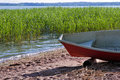 Rowing boat at sea shore Royalty Free Stock Image