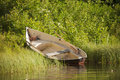 Rowing boat wooden on shore at forest lake Royalty Free Stock Photos