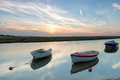 Rowing boats on the river moored at blakeney norfolk coast Royalty Free Stock Images