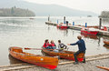 Rowing at bowness on windermere rowers the shore lake english lake district Stock Photography