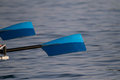 Rowing oars with blue blades Stock Photo