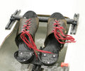 Rowing shoes with red laces a pair of on a shell these were wet raindrops on the leather and other materials Stock Images