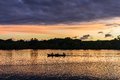Rowing at sunset silhouette of native malagasy on the canoe near nosy be madagascar Stock Photography