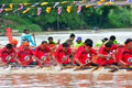 Rowing team race chumphon thailand oct unidentified rowers in climbing bows toward snatching a flag native thai long boats compete Royalty Free Stock Images