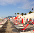 Rows of beach umbrellas and sun chairs Royalty Free Stock Images