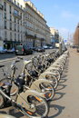 Rows of bicycles for rent lined up at the sidewalk,Paris,France,2016 Royalty Free Stock Photo