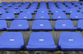 Rows of blue empty plastic chairs on stadium Stock Images