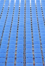 Rows of blue plastic chairs Royalty Free Stock Image