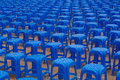 Rows of Blue Plastic Stools Royalty Free Stock Image