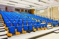 Rows of blue seats in lecture hall. Royalty Free Stock Photo
