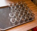 stock image of  Rows of bottom up clear glasses arranged over rubber mesh