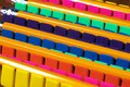 Rows of brightly colored pencil erasers lined up in an OCD order Royalty Free Stock Photo