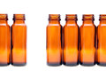 Rows of brown glass bottles isolated on white background Royalty Free Stock Photo