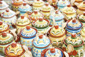 Rows of ceramic jugs various colorful standing in Stock Images