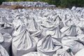Rows of charcoal bags lying in in sunshine day on nature background Stock Image
