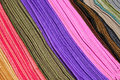 Rows of colored scarves at the Otavalo market Stock Image