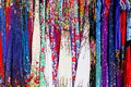 Rows of colourful silk scarfs hanging at a market stall in Thail Royalty Free Stock Photo