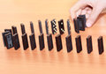 Rows of dominoes action activity starting Royalty Free Stock Image