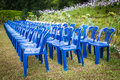 Rows of empty blue and white chairs waiting for the audience Royalty Free Stock Photo
