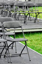 Rows of empty seats ready for outdoor wedding or concert Stock Photos
